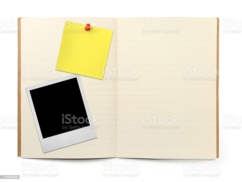 exercise book with photo frame and yellow note stock photo