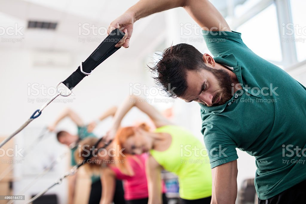 Exercise class on Pilates machines in a health club. stock photo