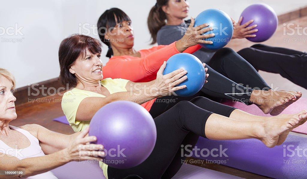 Exercise class using fitness balls stock photo