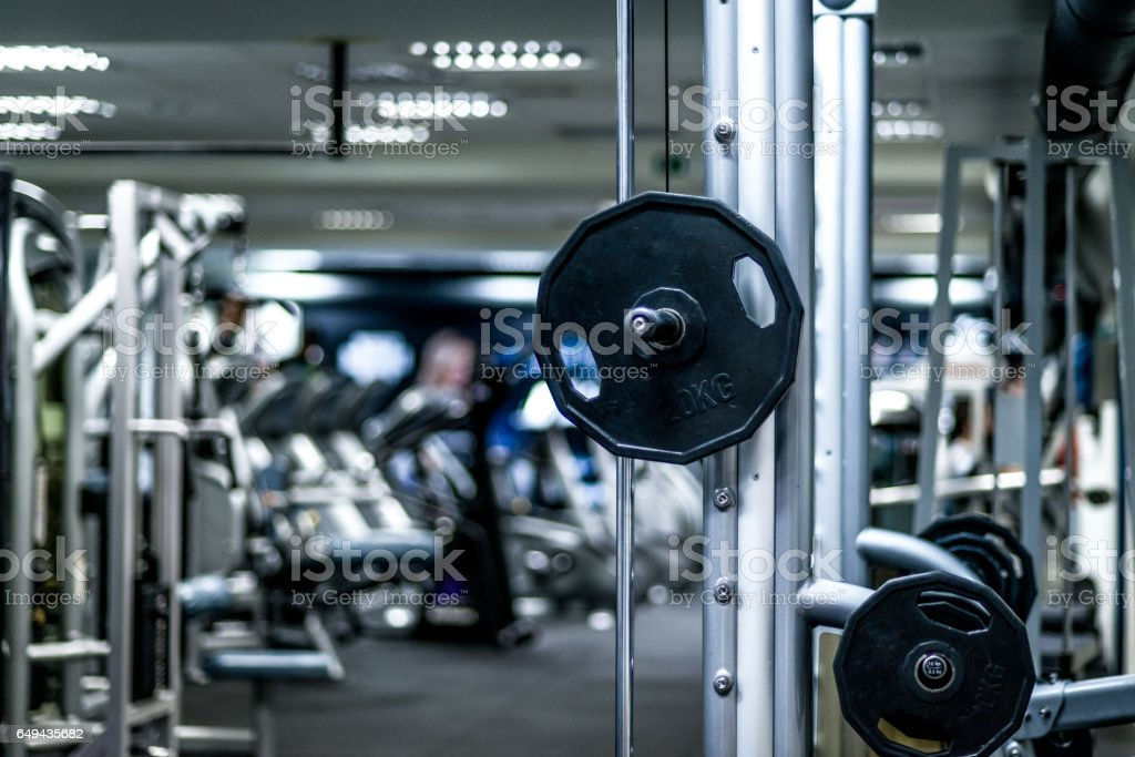 Weight Training Room. Behind is a lot of fitness equipment and...