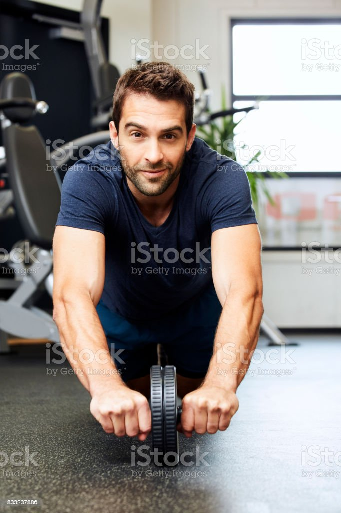Exercise guy in gym stock photo