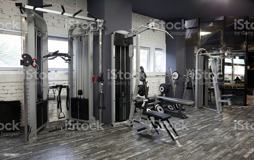 Exercise machines in gym stock photo