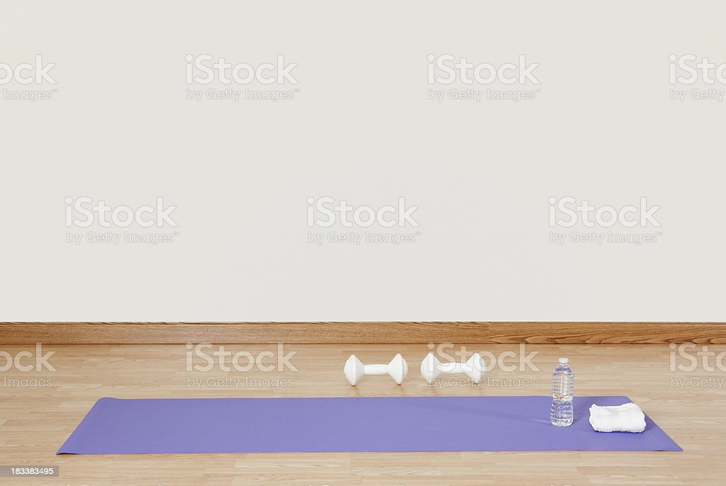 Exercise Mat with Dumbbells stock photo