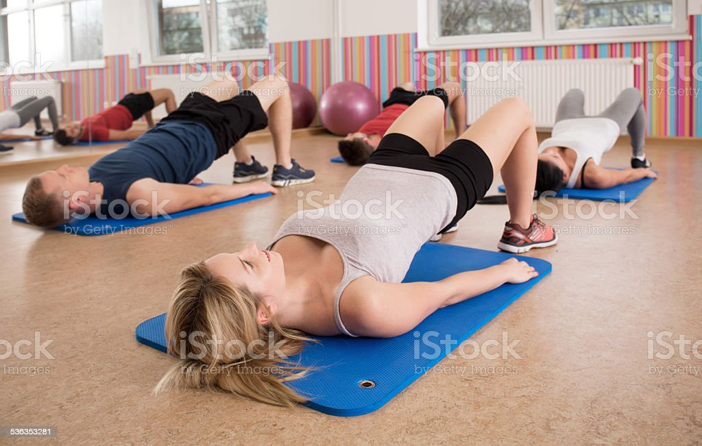 Exercise on gym floor mats stock photo