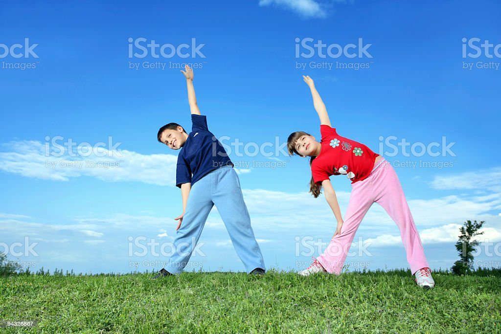 Exercise on meadow. royalty-free stock photo