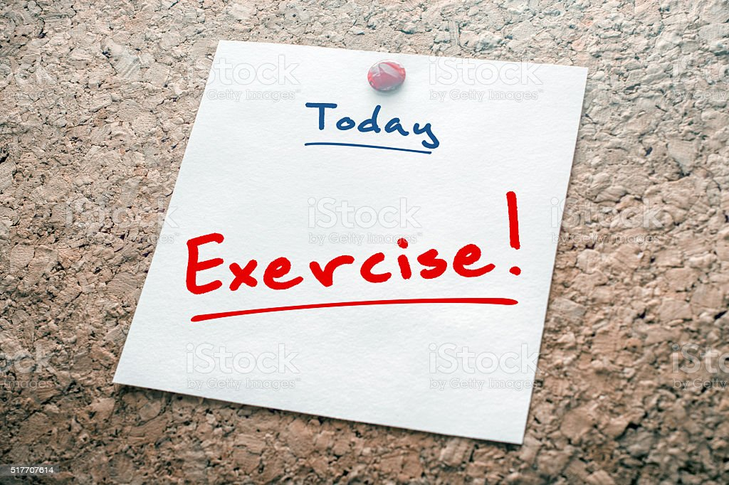 Exercise Reminder For Today On Paper Pinned On Cork Board stock photo