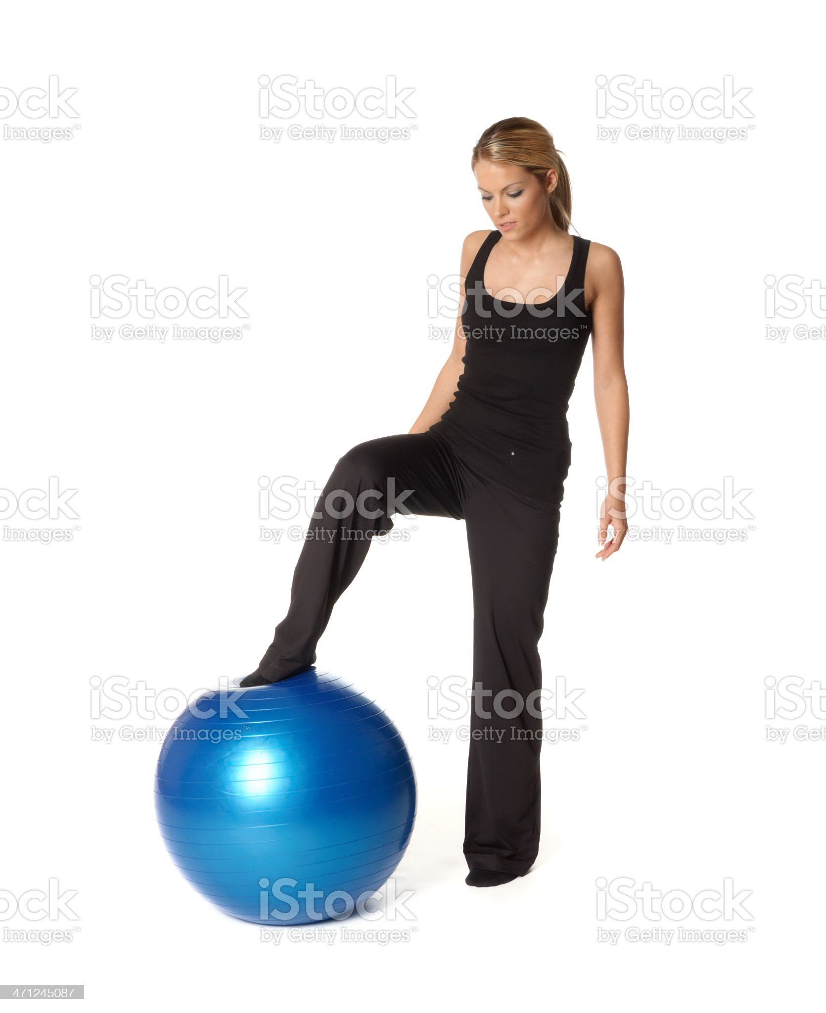 Exercise with a blue fitness ball royalty-free stock photo