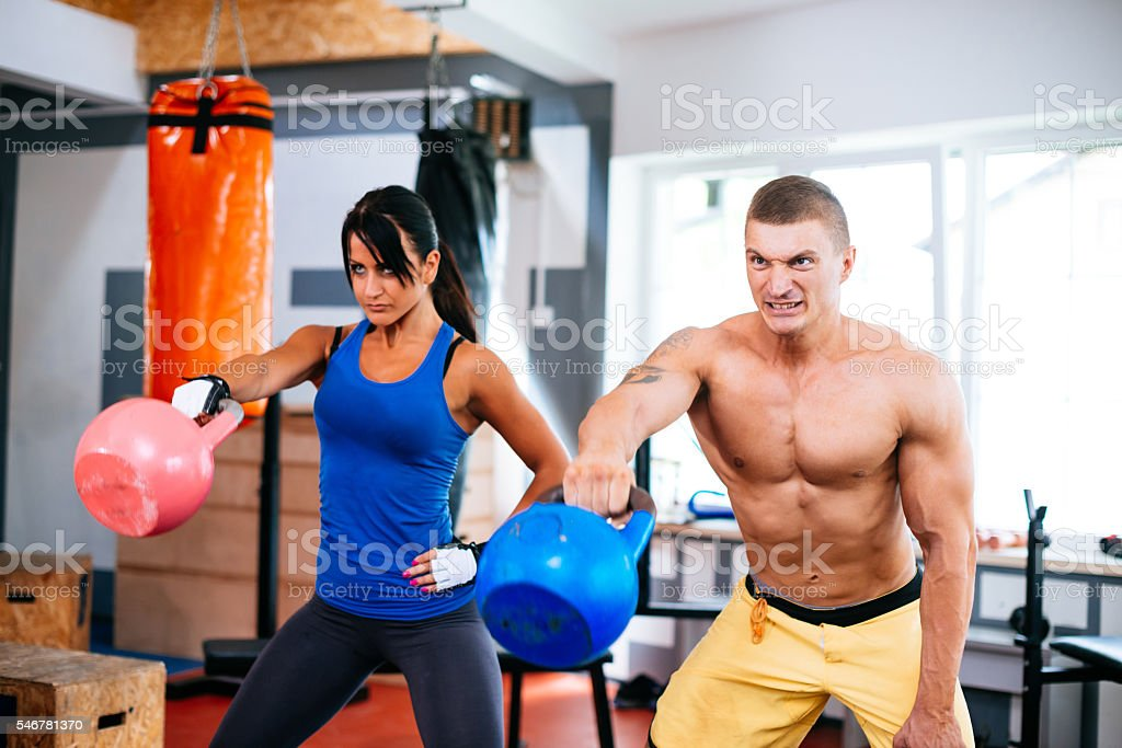 Exercise with kettle bells in cross training gym stock photo
