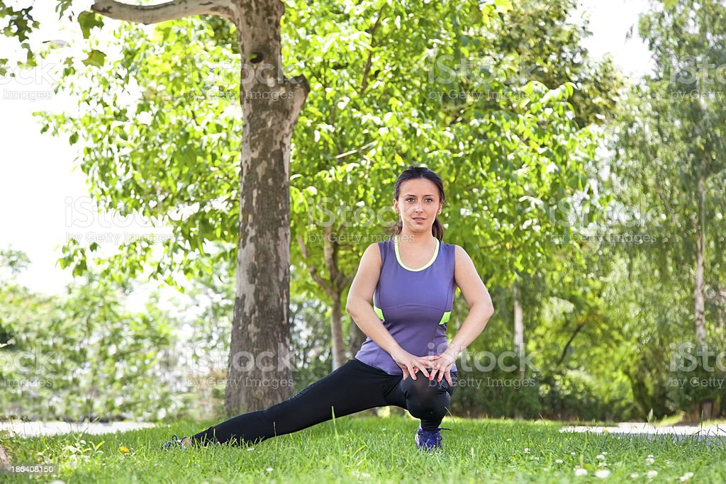Exercise woman stretching hamstring leg muscles during outdoor running workout. royalty-free stock photo