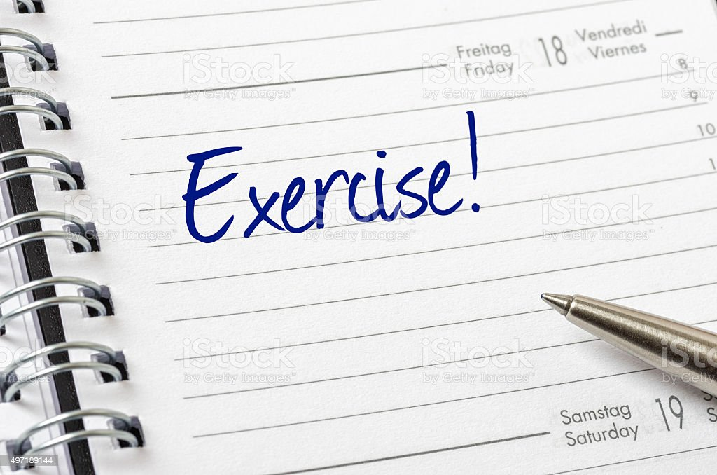 Exercise written on a calendar page stock photo