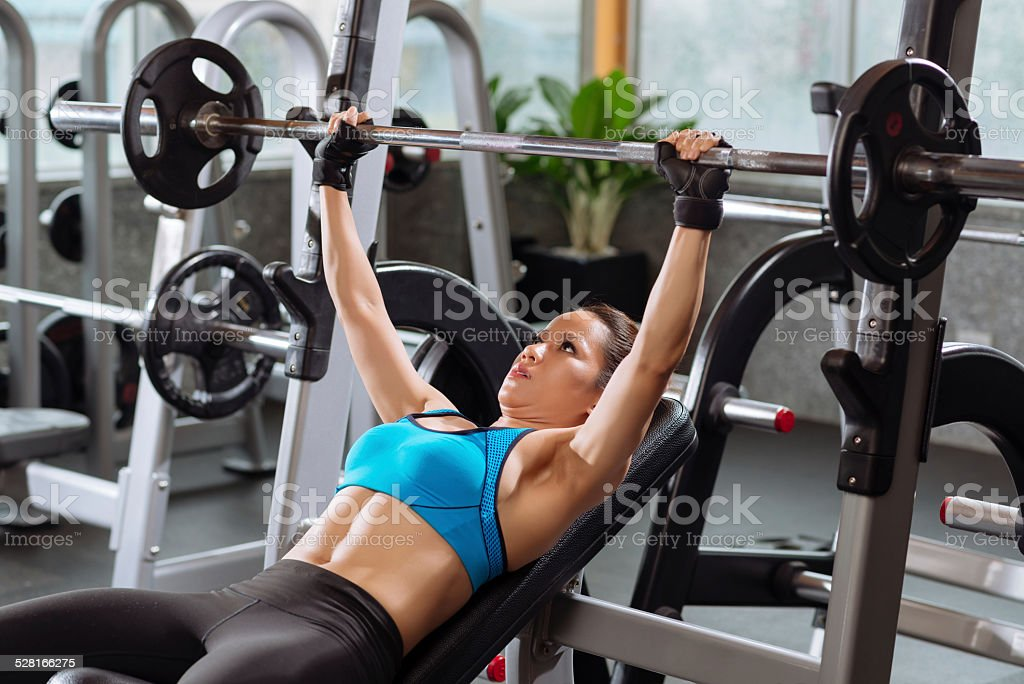 Exercises with barbell stock photo
