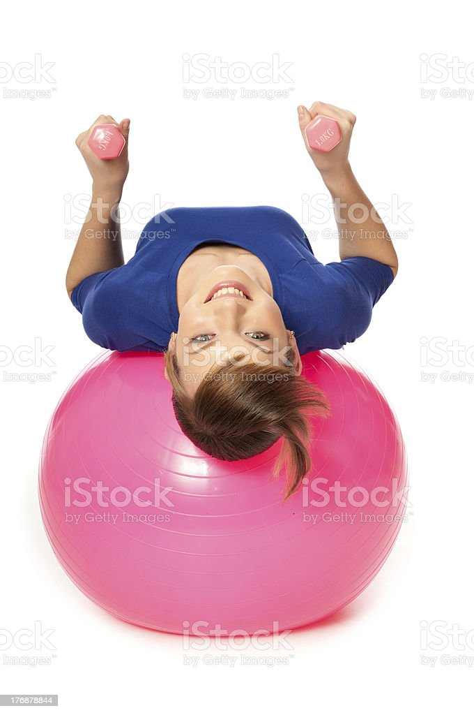 Exercises with dumbbells on a gymnastic ball royalty-free stock photo