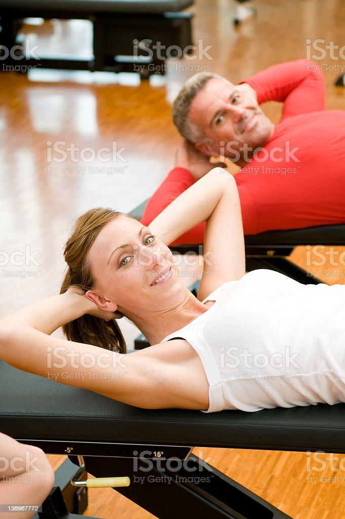 Exercising at gym royalty-free stock photo