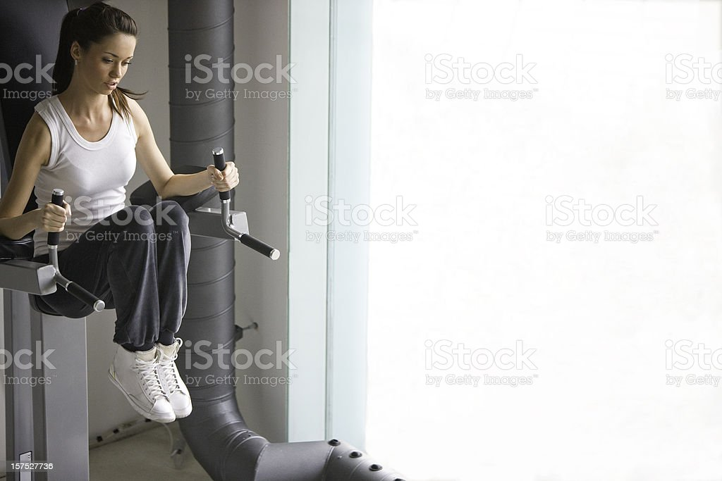 Exercising in a gym stock photo