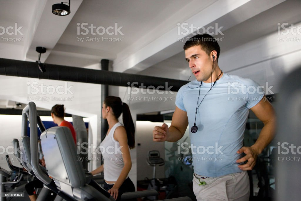 Exercising in a gym royalty-free stock photo