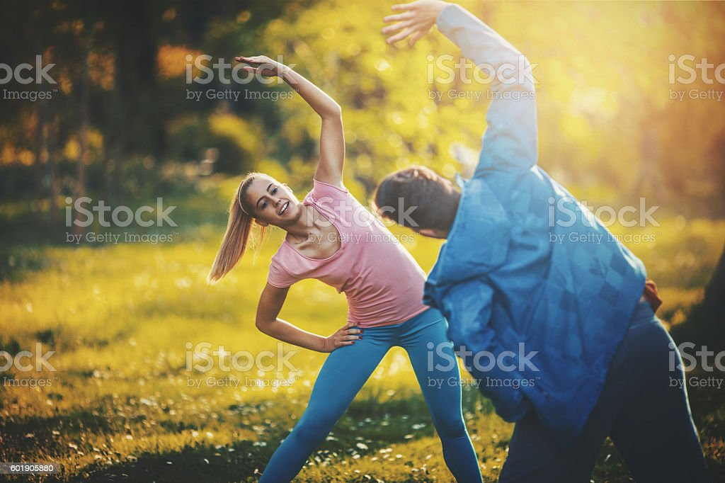 Exercising in a park. stock photo