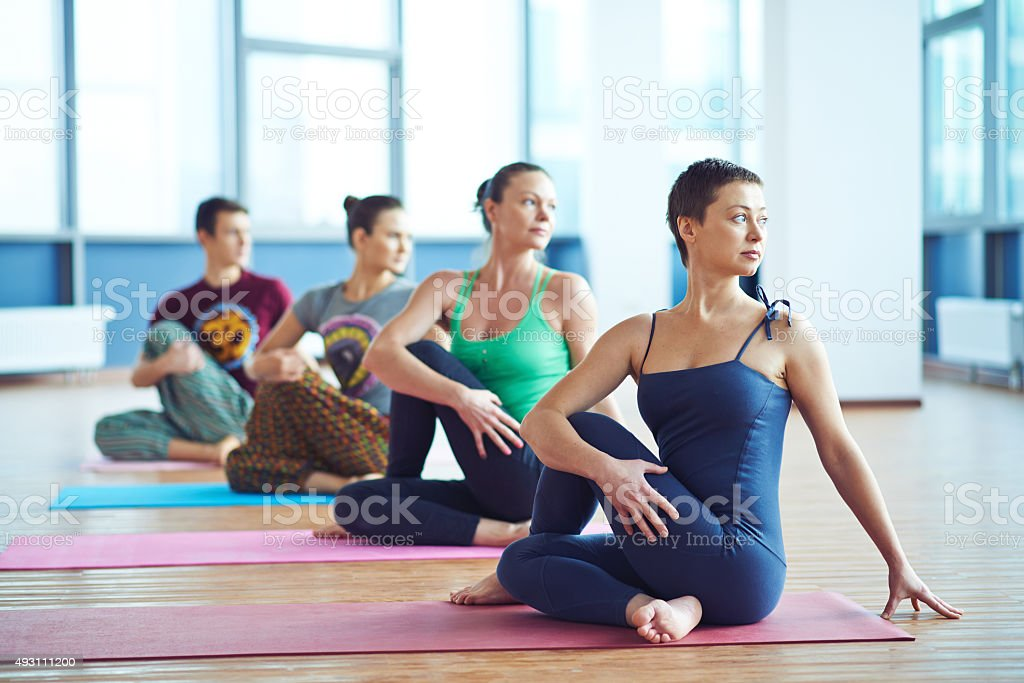 Exercising in gym stock photo