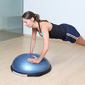 exercising in the gym on a stability disc
