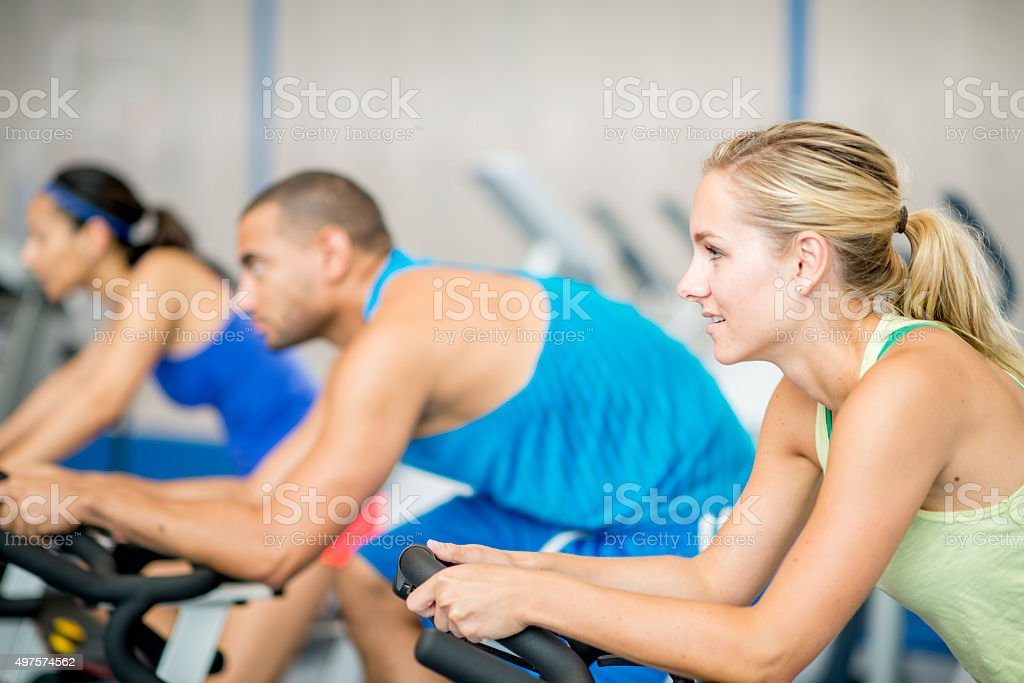 Exercising on a Bike in the Gym stock photo