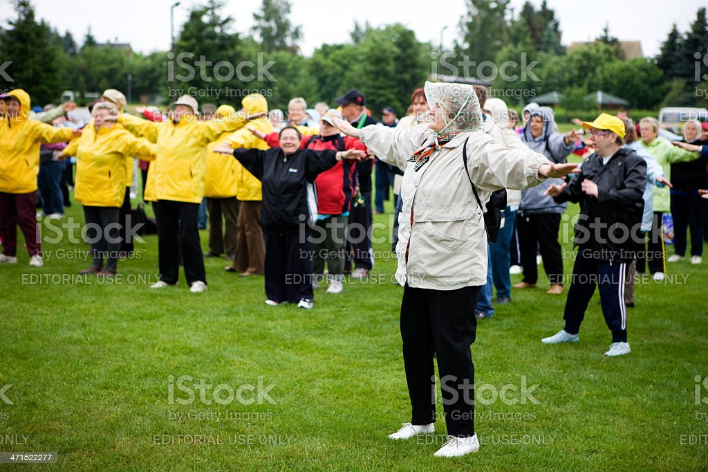 exercising seniors on sports event stock photo