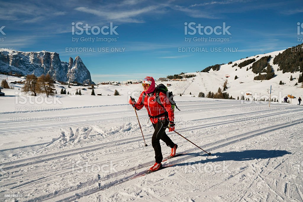 exercising winter sports athlete skiing in scenic landscape Seiser Alm stock photo