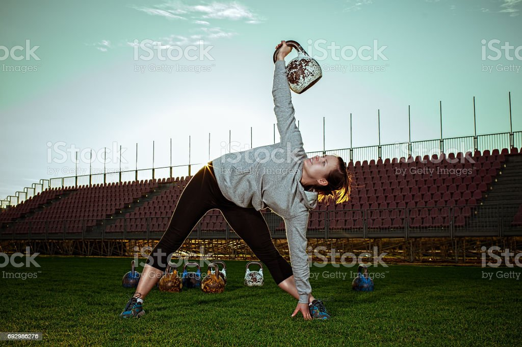 Exercising with a kettlebell stock photo