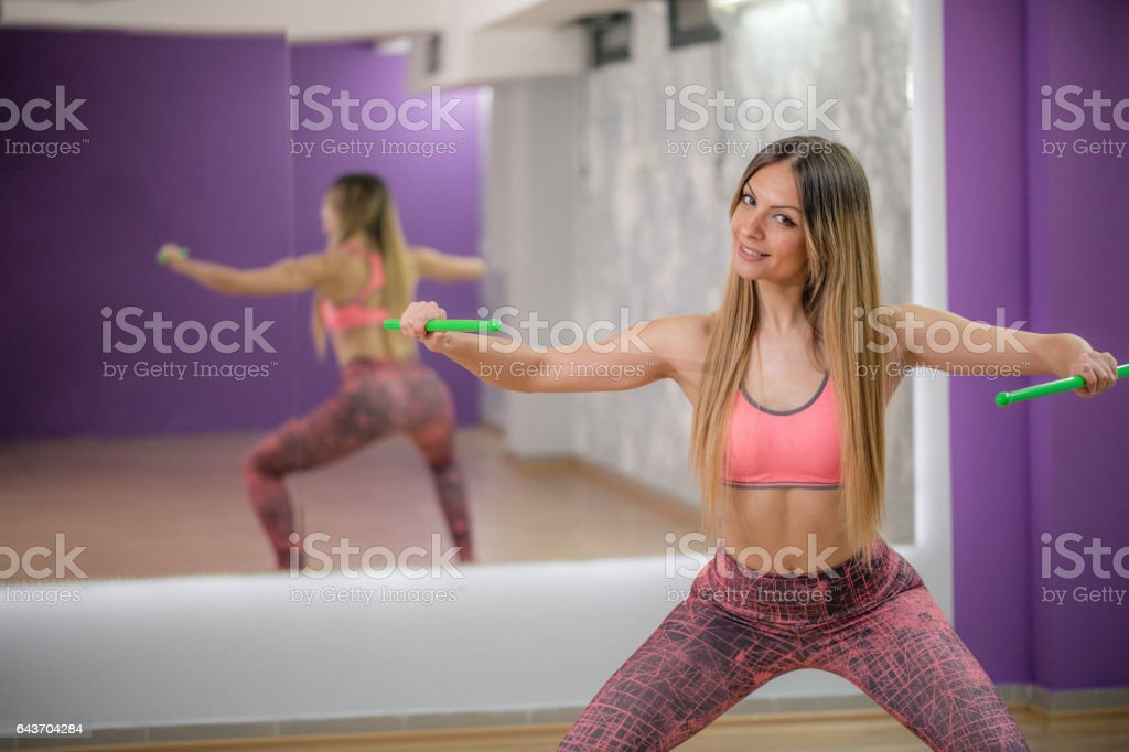 Exercising with drumsticks stock photo