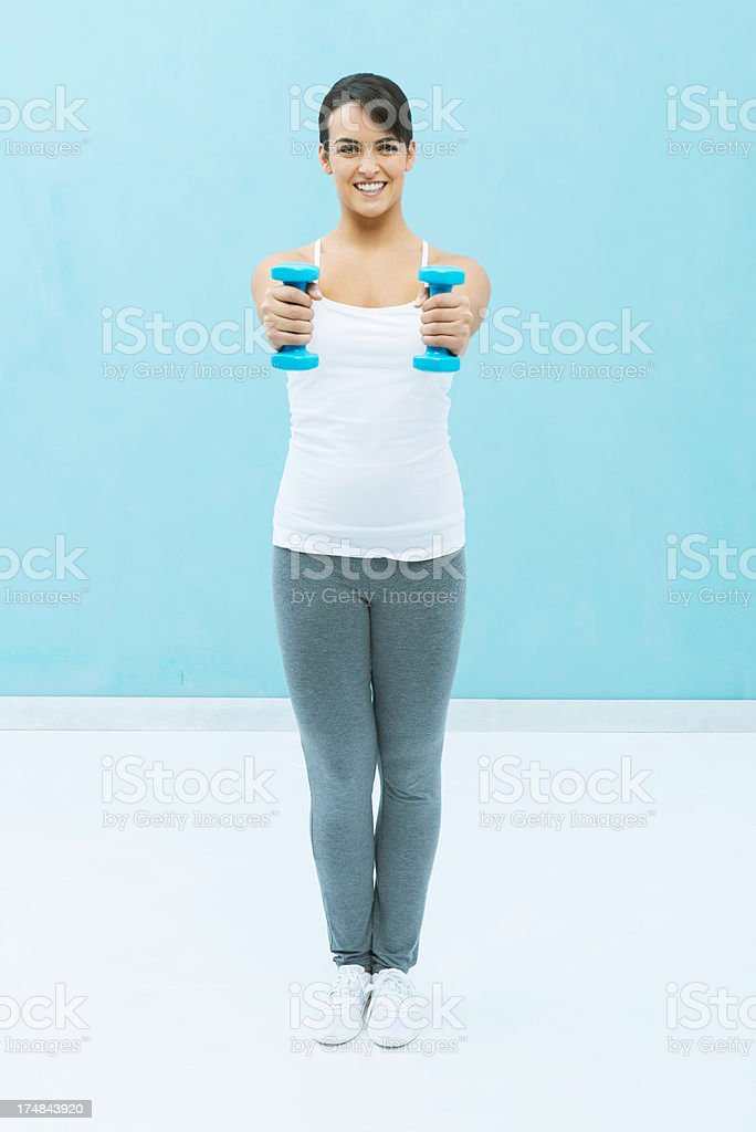 Exercising with dumbbells royalty-free stock photo