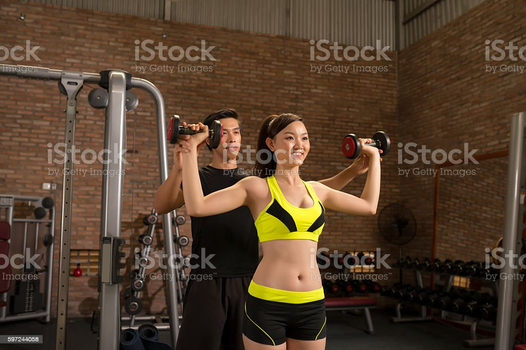 Exercising with dumbells stock photo
