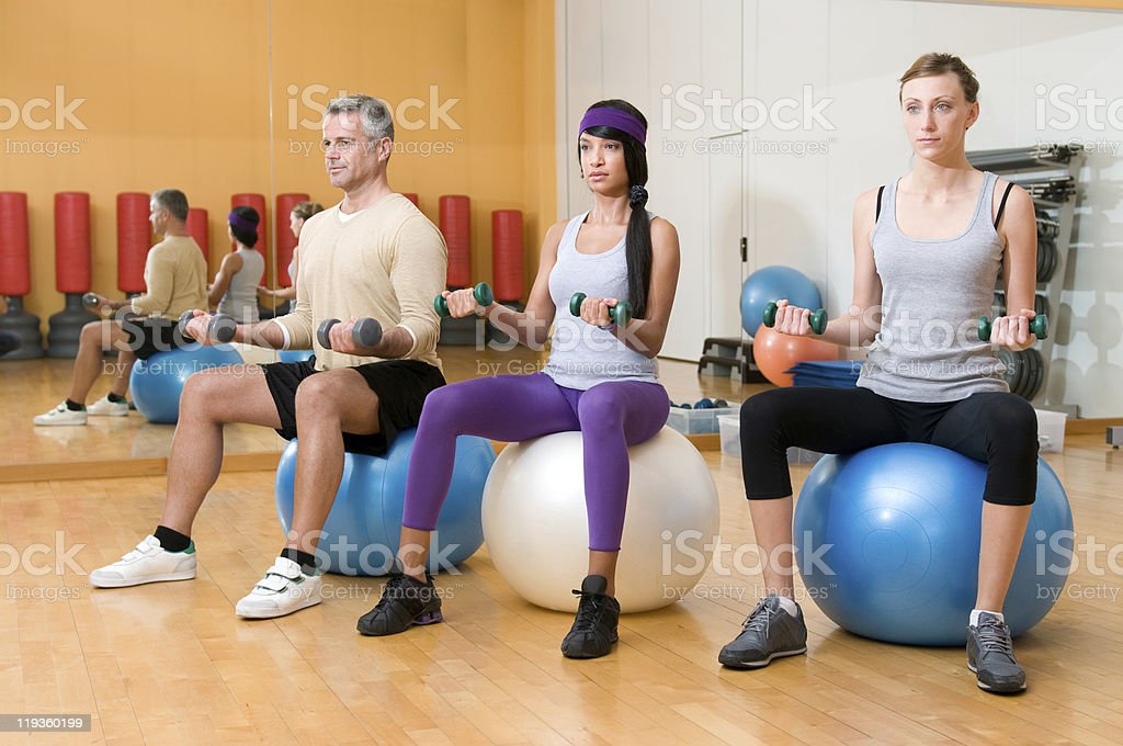 Exercising with fitness ball royalty-free stock photo