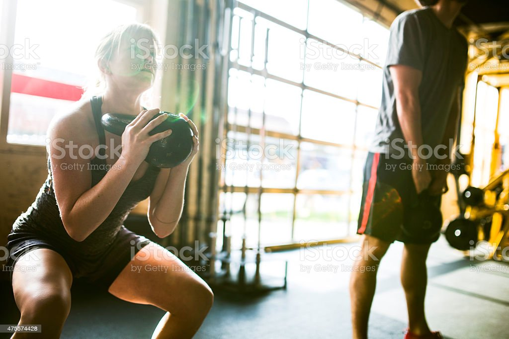 Exercising with Kettlebells Gym stock photo