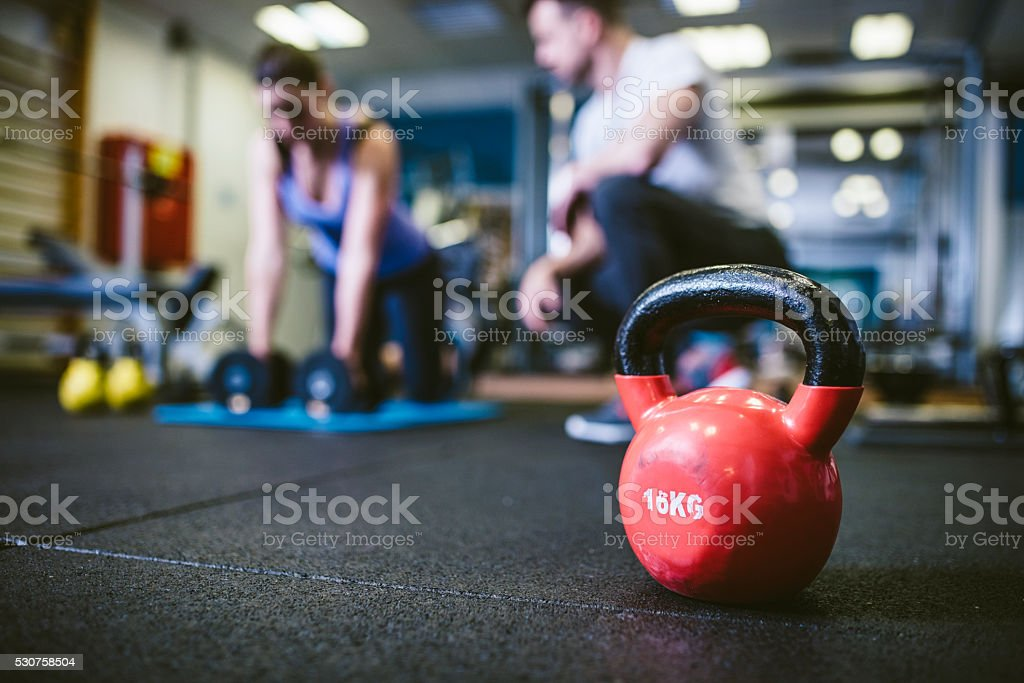 Exercising with personal trainer stock photo