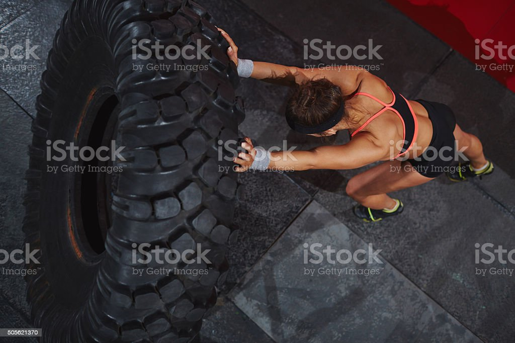 Exercising with tyre stock photo