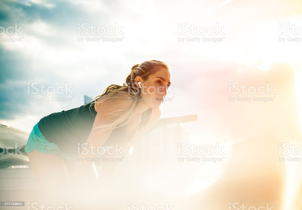 Exercising woman outdoors stock photo