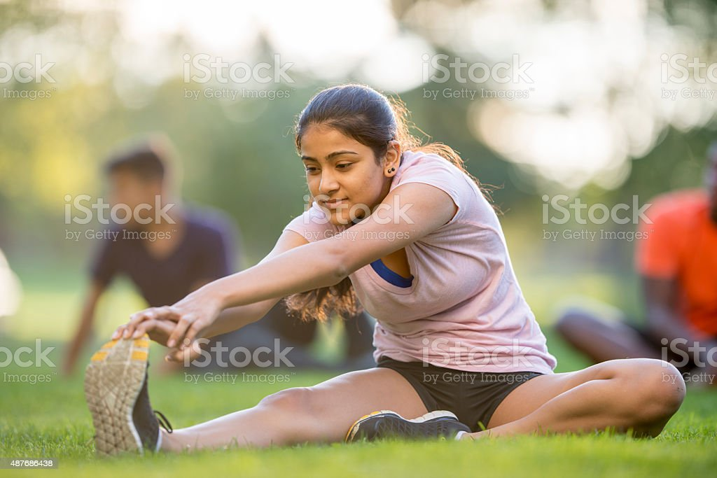 Exersizing and Stretching in the Park stock photo