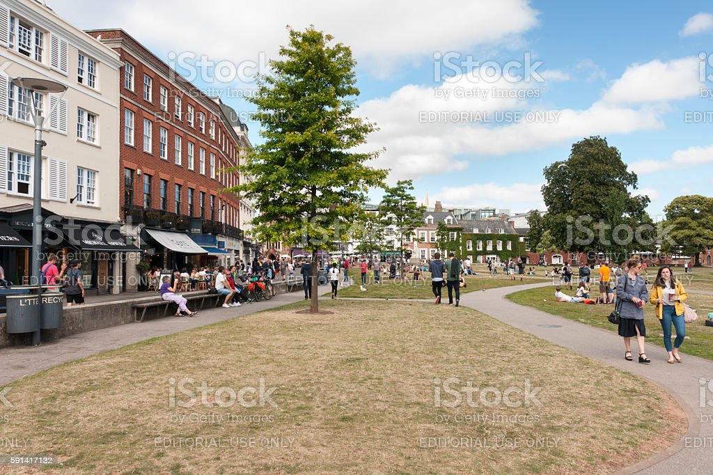Exeter cathedral green and shopping area with people relaxing stock photo