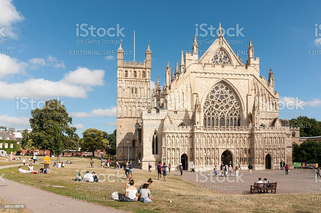 Exeter cathedral green in summer with people relaxing stock photo