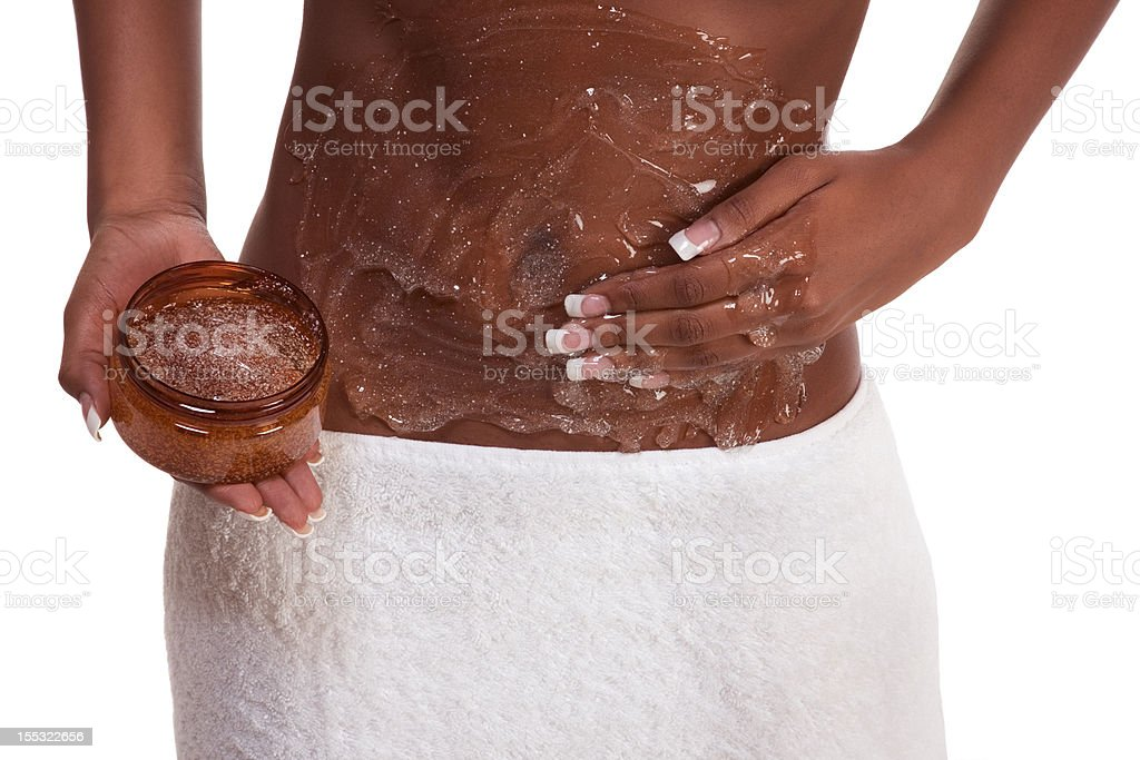 Exfoliation Woman Putting scrub on abdomen stock photo