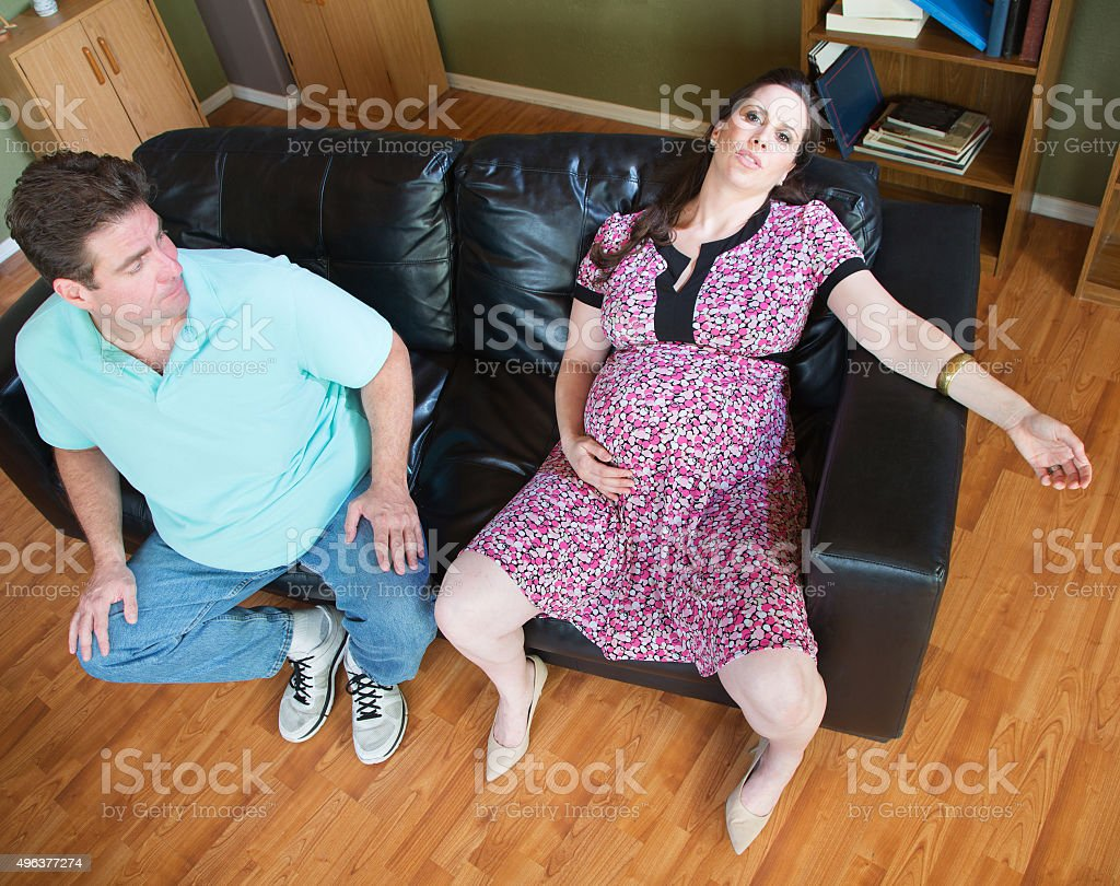 Exhaused Expecting Woman and Husband stock photo