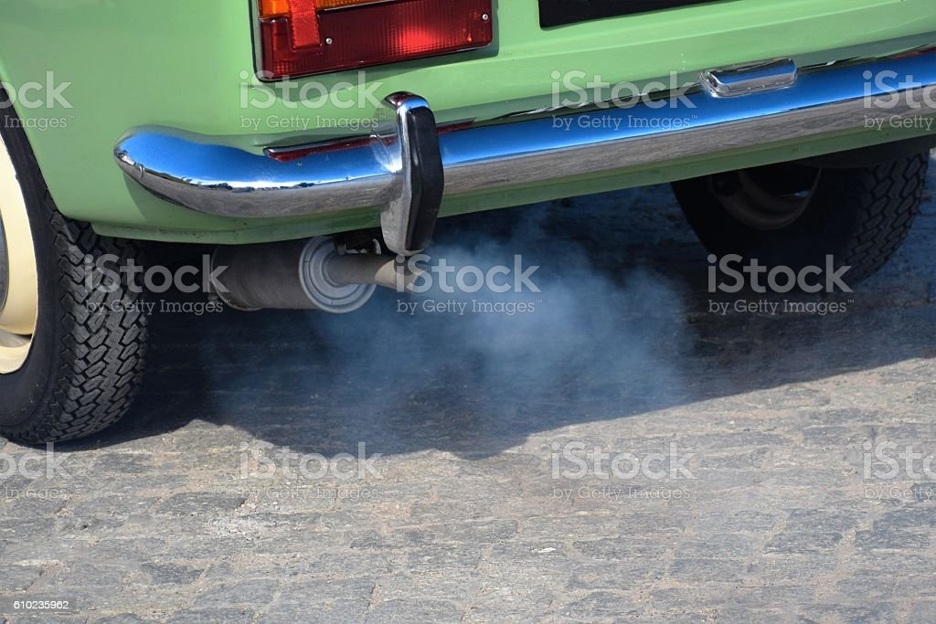Exhaust fumes from old car stock photo