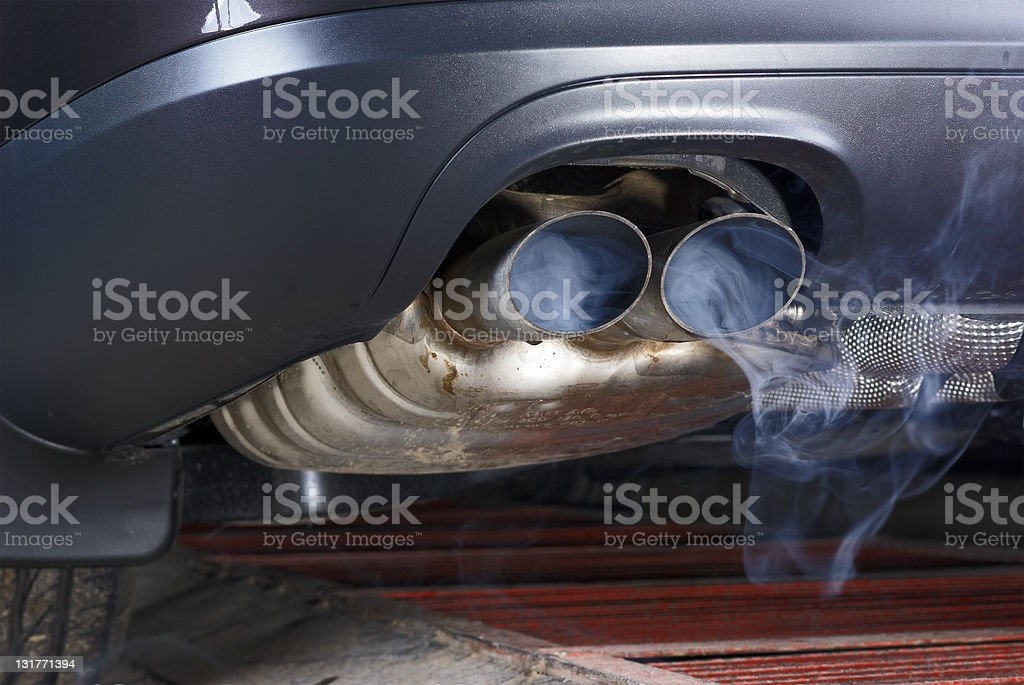 Exhaust pipe of a car - blowing out the pollution. stock photo