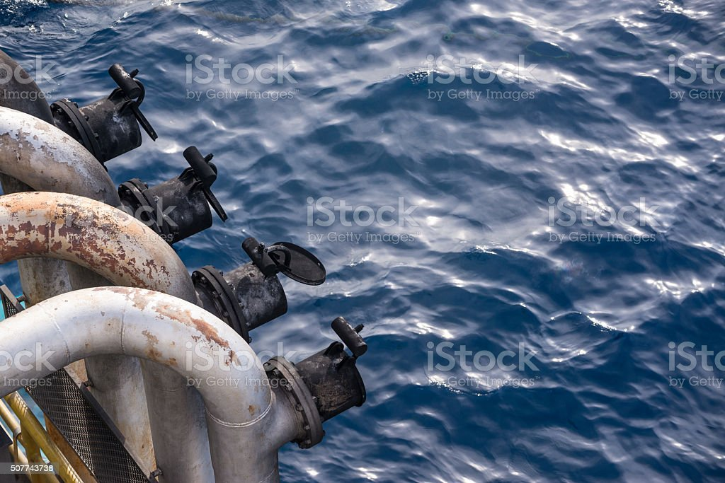 Exhaust pipes head at jack up oil rig port side stock photo