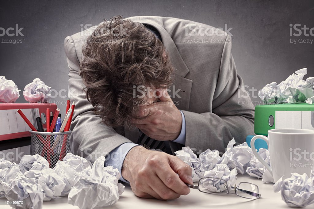 Exhausted and overworked stock photo