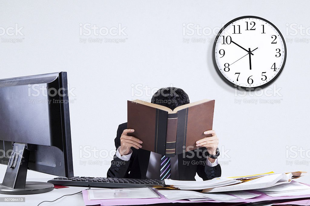 Exhausted businessman in office 2 stock photo