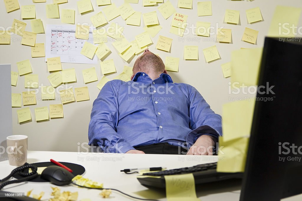 Exhausted Businessman stock photo