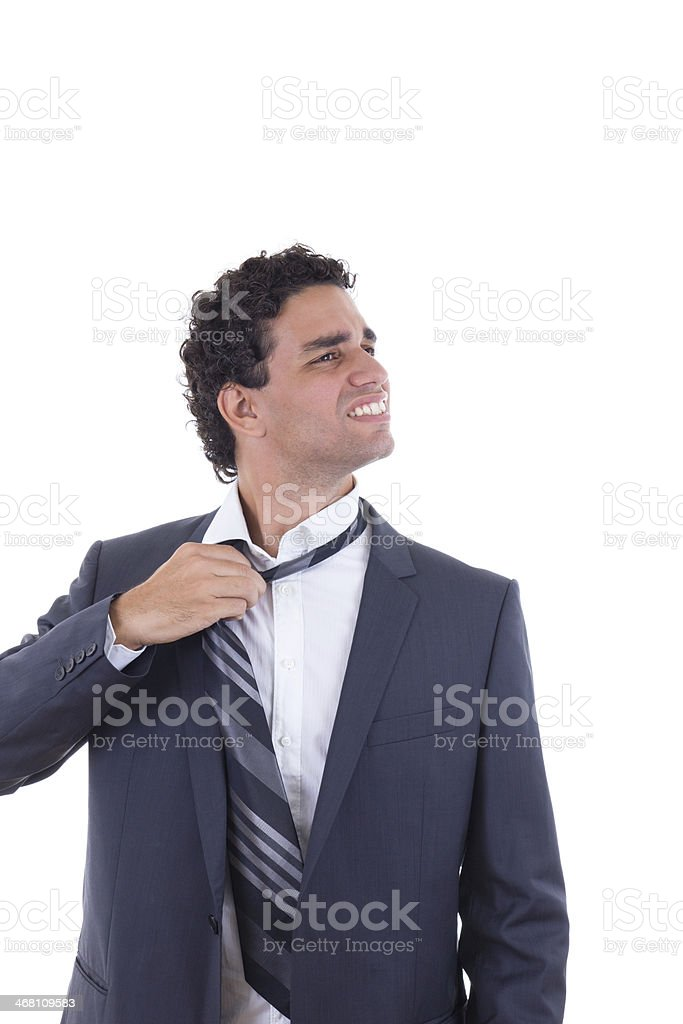 exhausted businessman removing tie stock photo