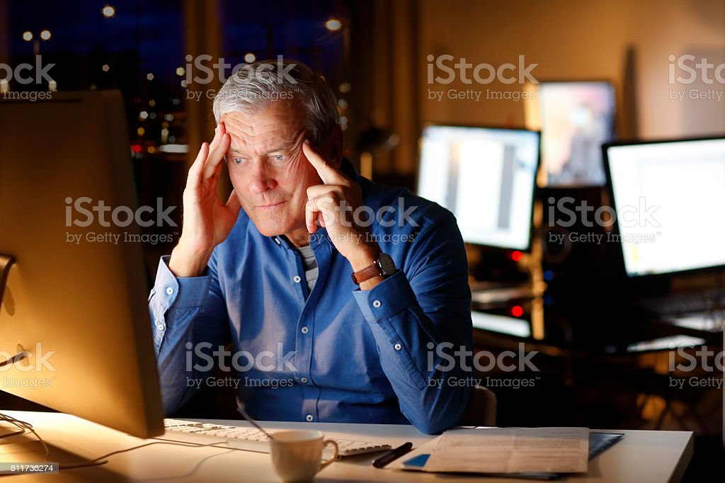 Exhausted businessman working late night stock photo