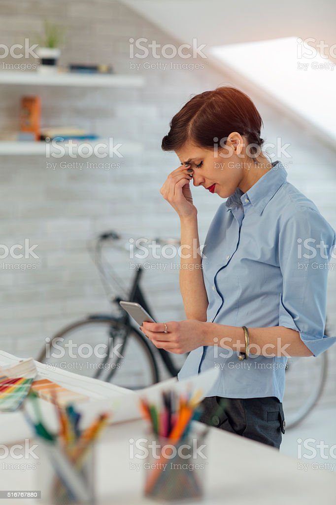 Exhausted Businesswoman Working In Her Office. stock photo