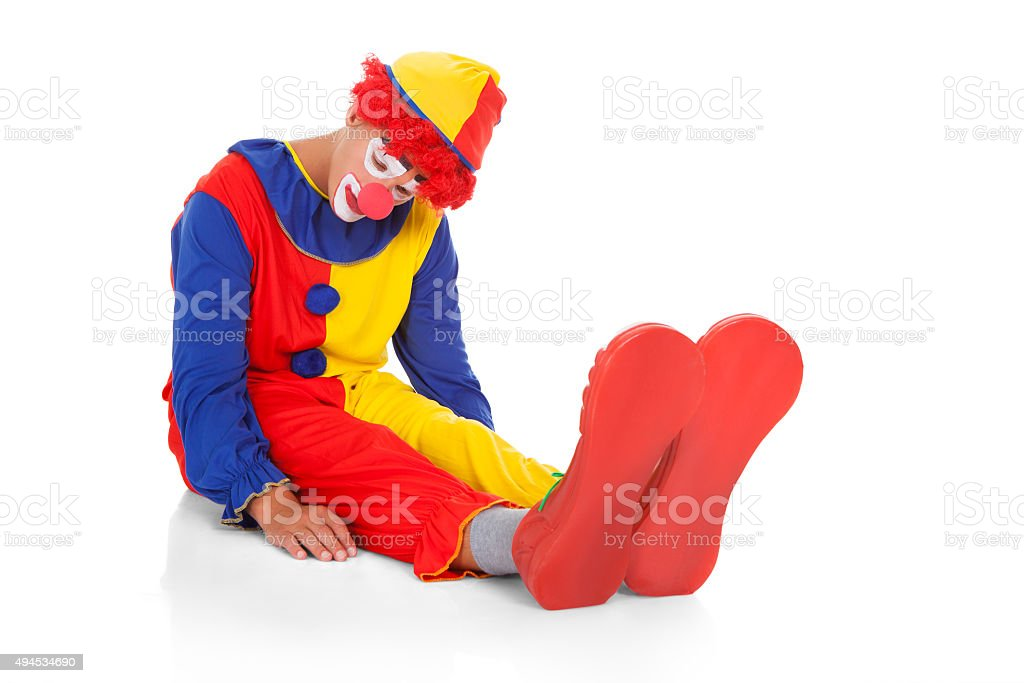 Exhausted Clown Lying On Front stock photo