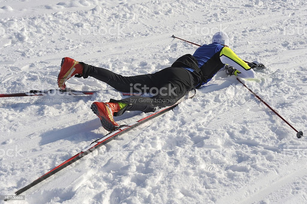 Exhausted cross country skier at the end of race stock photo